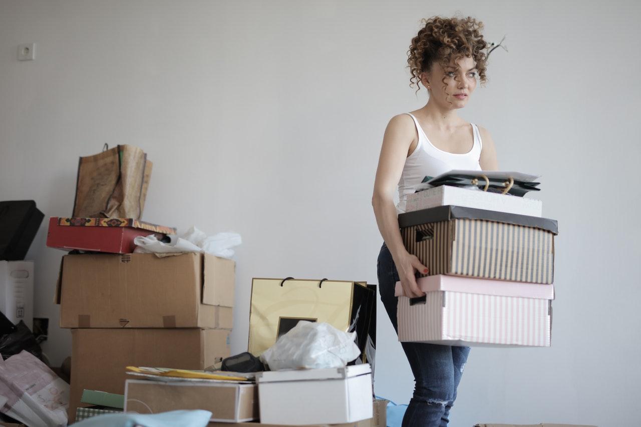woman organizing messy storage room